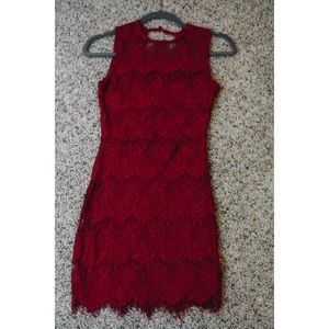 Red lace body con dress